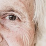 Close Up Image Of Old Woman's Eye, Looking At Camera