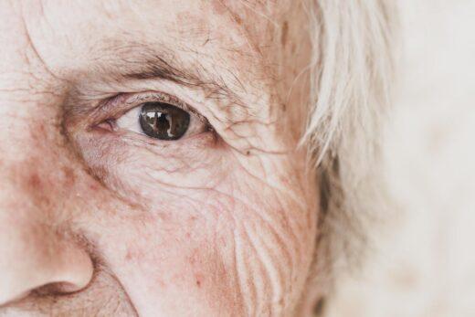 Close Up Image Of Old Woman's Eye, Looking At Camera